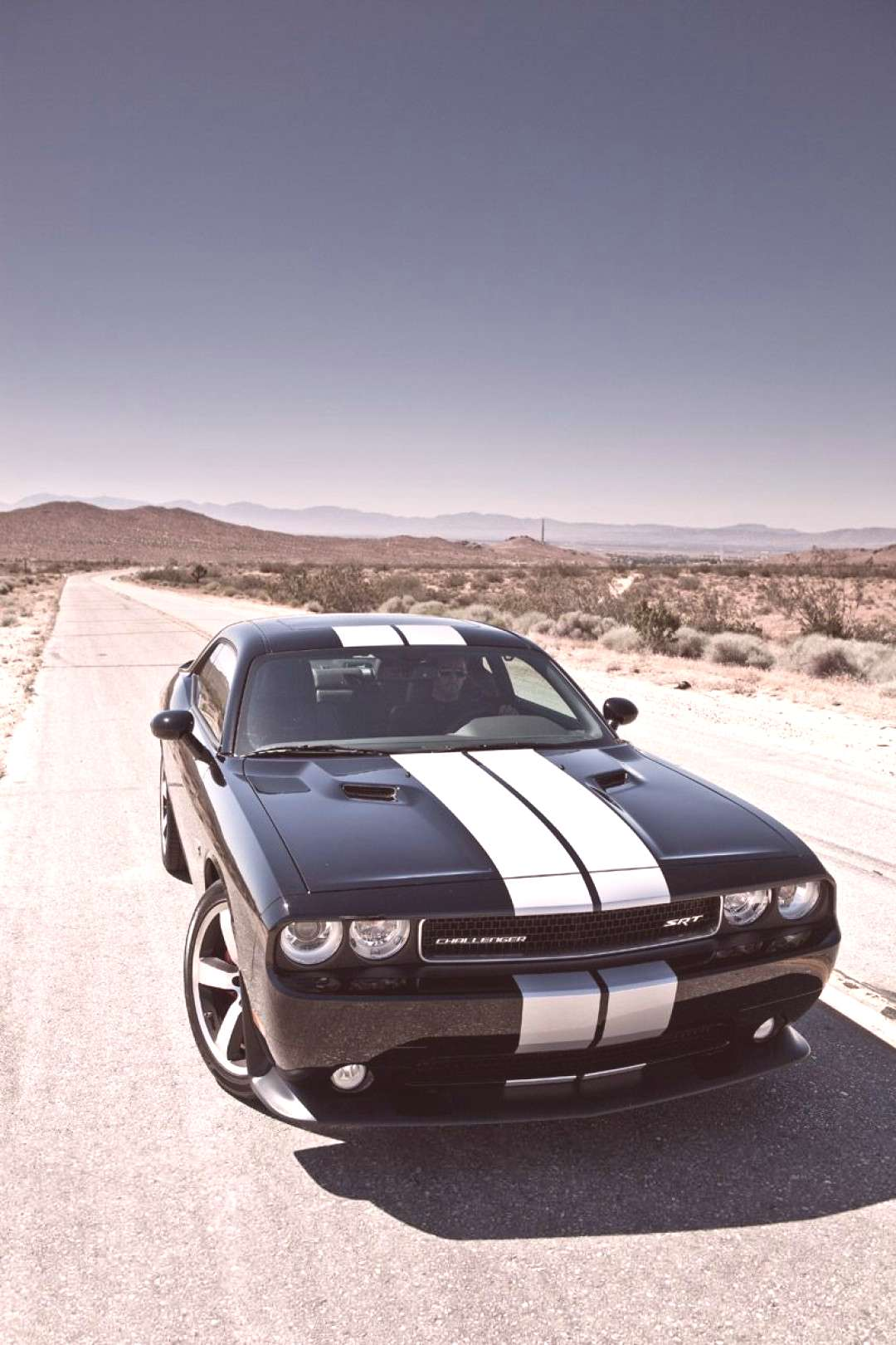 2012 Dodge Challenger SRT or the charger Ill take either one )