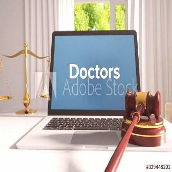 Doctors ¨C Law, Judgment, Web. Laptop in the office with term on the screen. Hammer, Libra, Lawyer