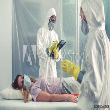 Doctors with bacteriological protection suits examining a patient ,