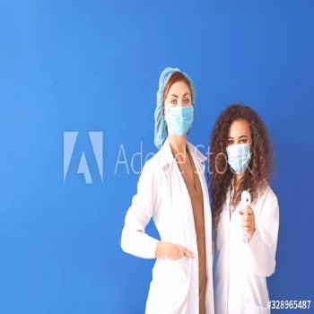 Female doctors with protective masks and thermometer on color background. Concept of epidemic ,