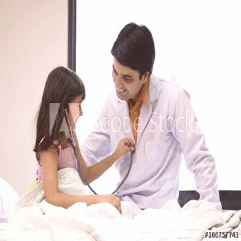 Girl checking a doctors heartbeat ,