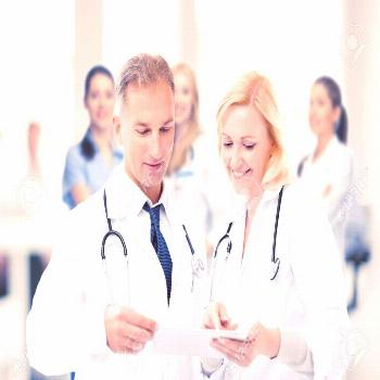 healthcare and technology concept - two doctors looking at tablet pc Stock Photo ,