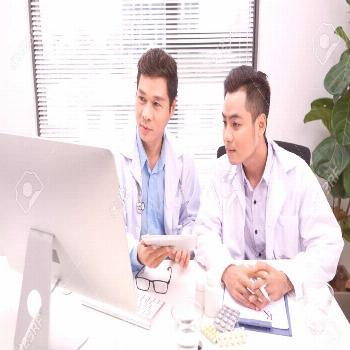 Two doctors holding and talking about patient on office Stock Photo ,