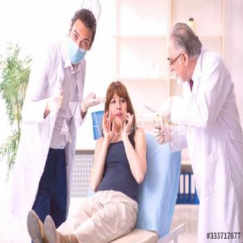 Two male doctors and young woman in plastic surgery concept ,