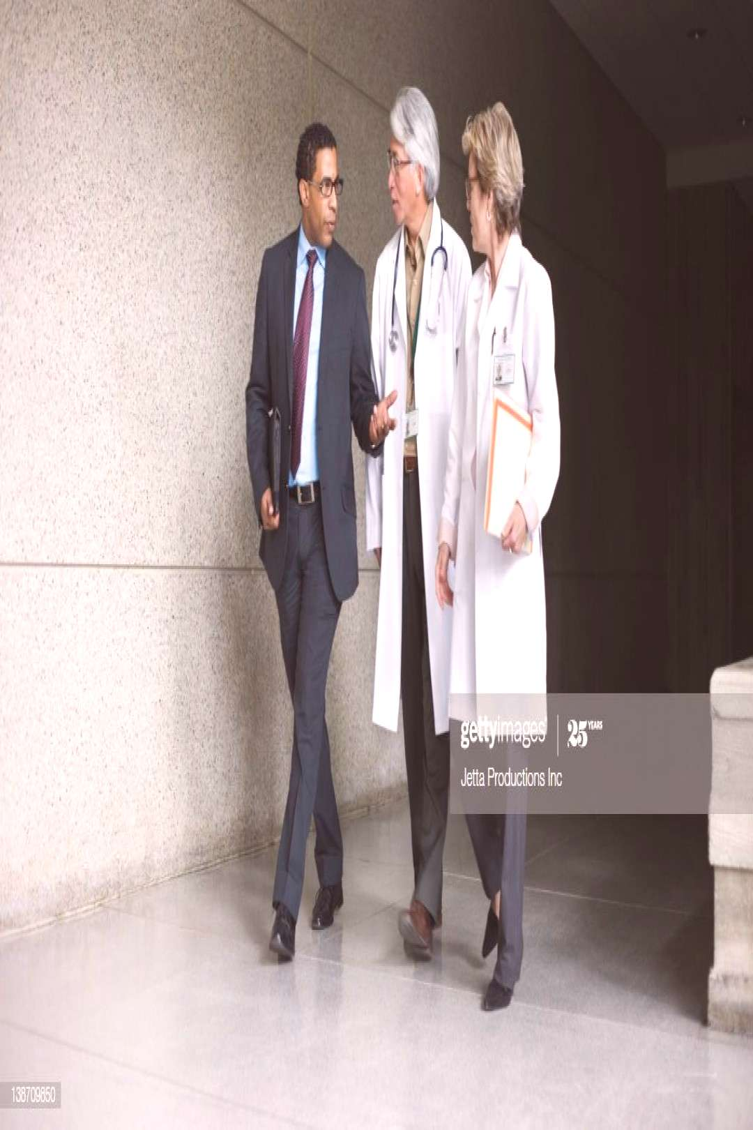 Businessman Talking To Doctors Photography ,