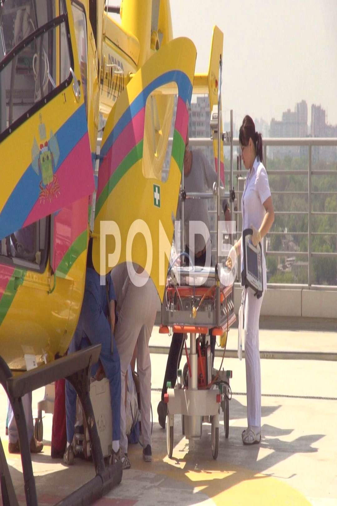 Doctors evacuate patient delivered by medical helicopter EC135 RA-07270. Stock Footage ,#delivered#