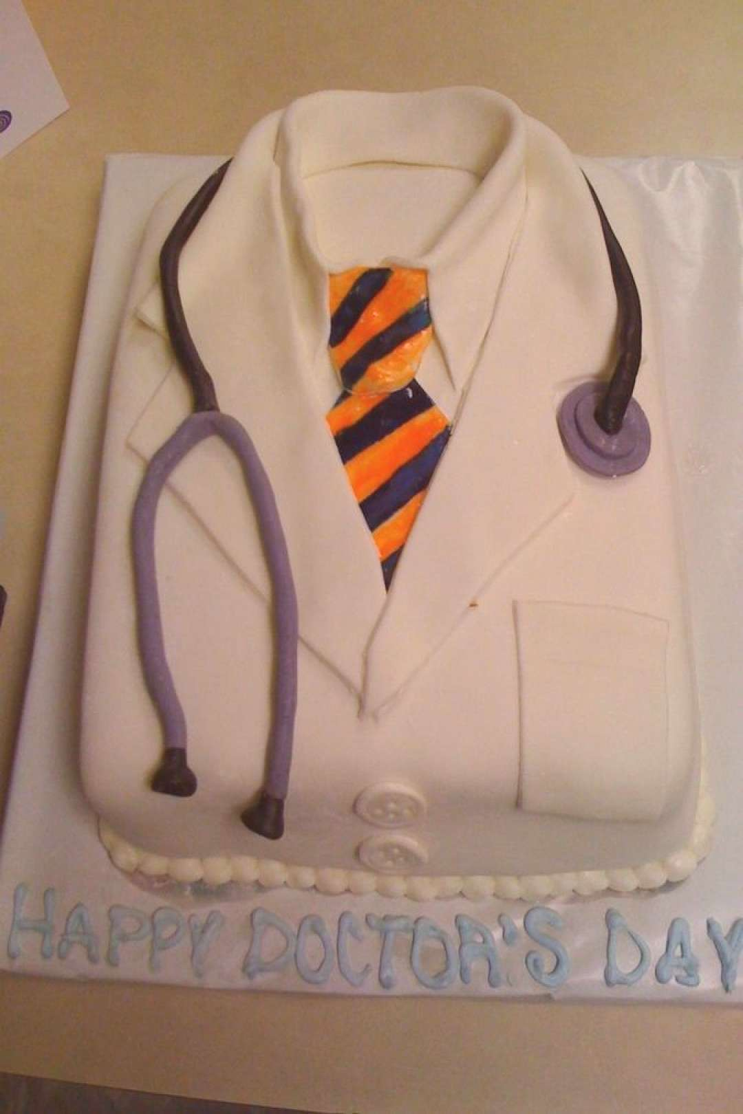 I did this cake for my boss on doctor's day.  Thanks for all the wonderful ideas... I did this cake