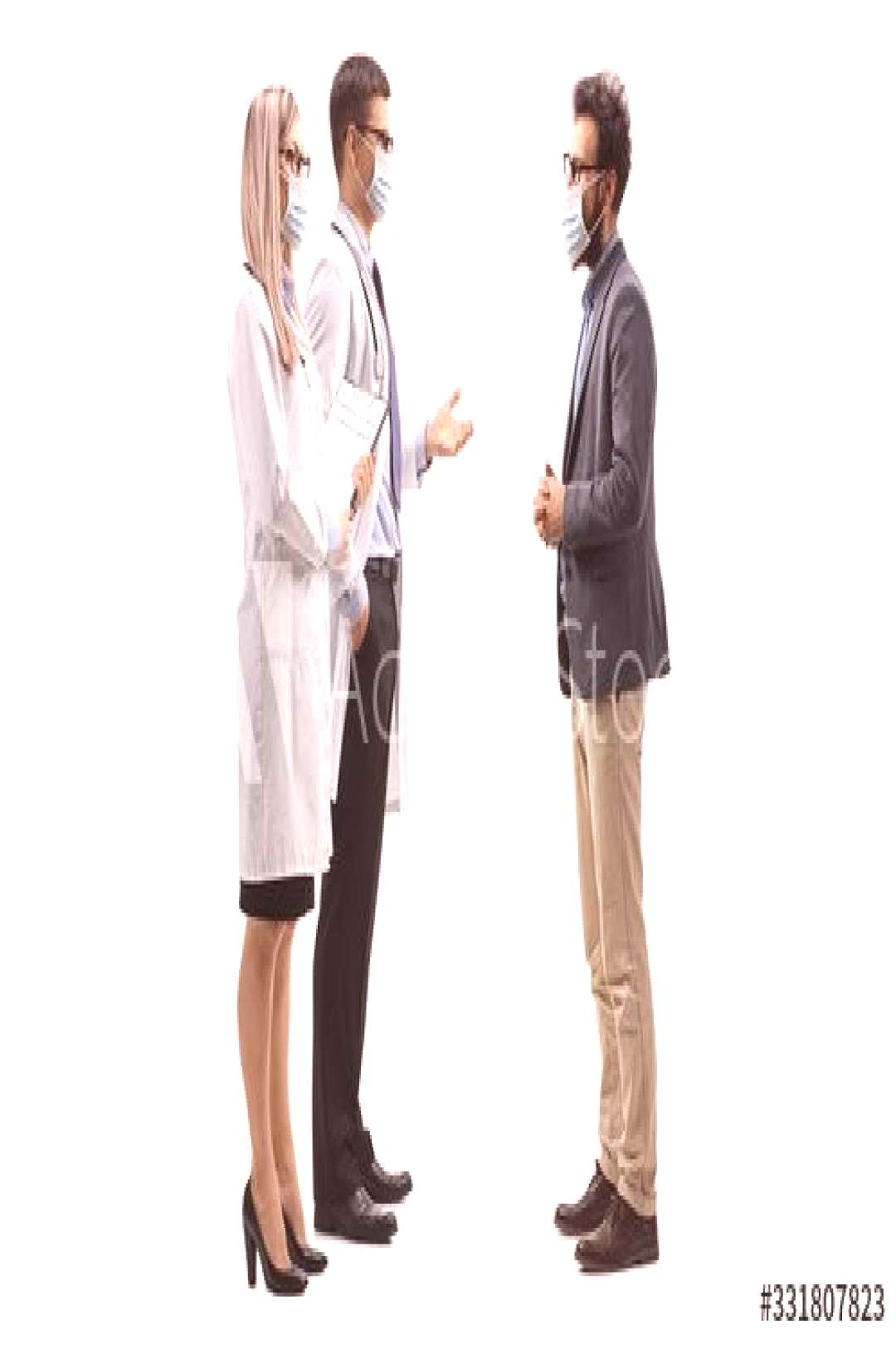 Male and female doctors wearing protective medical masks and talking to a man with a medical face m