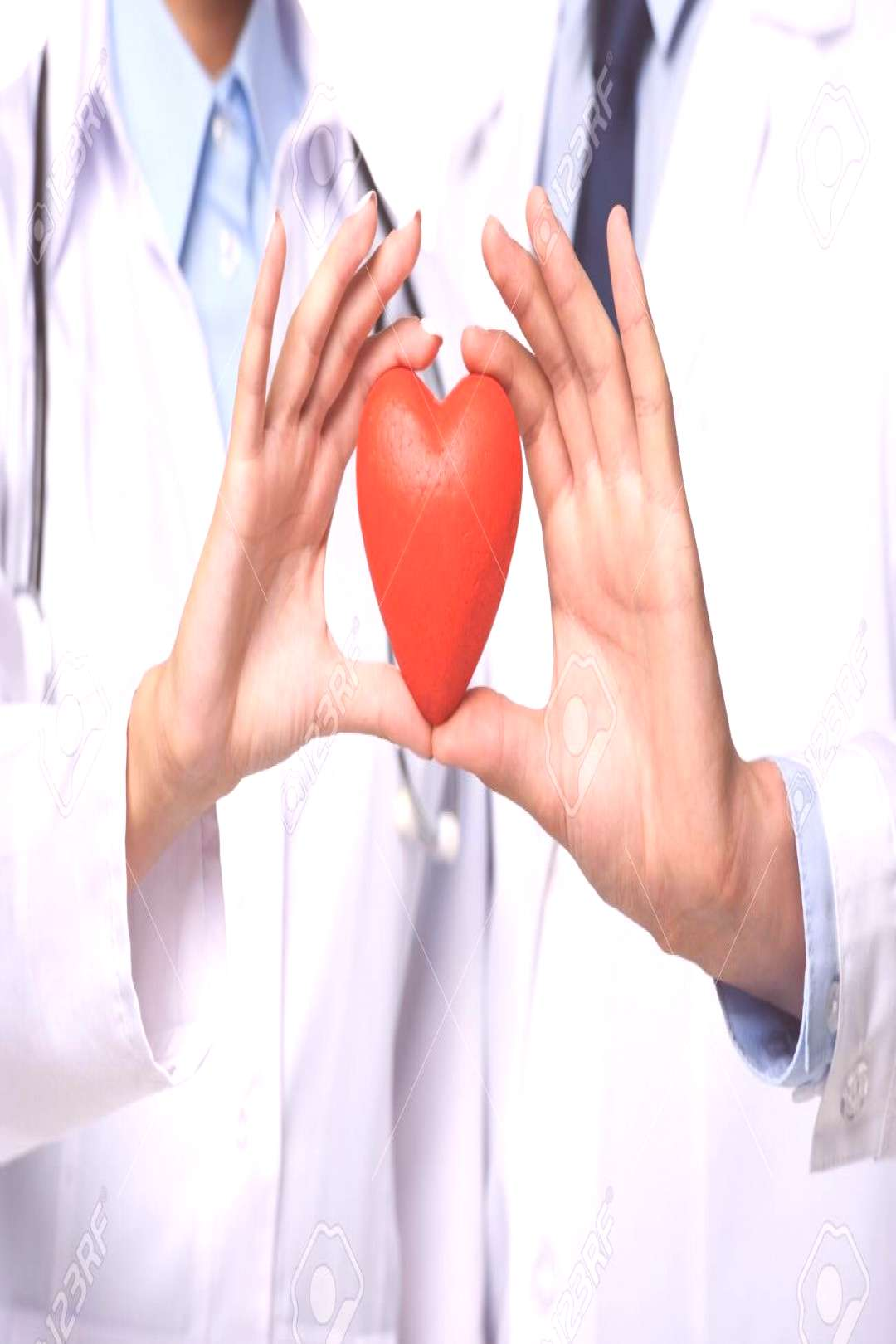 partial view of two doctors holding red heart in hands, isolated on white ,