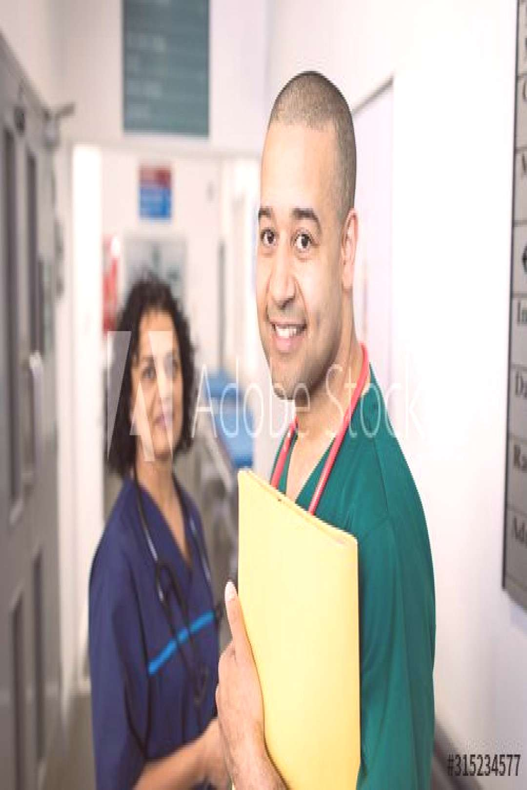 Portrait confident doctors in hospital corridor ,