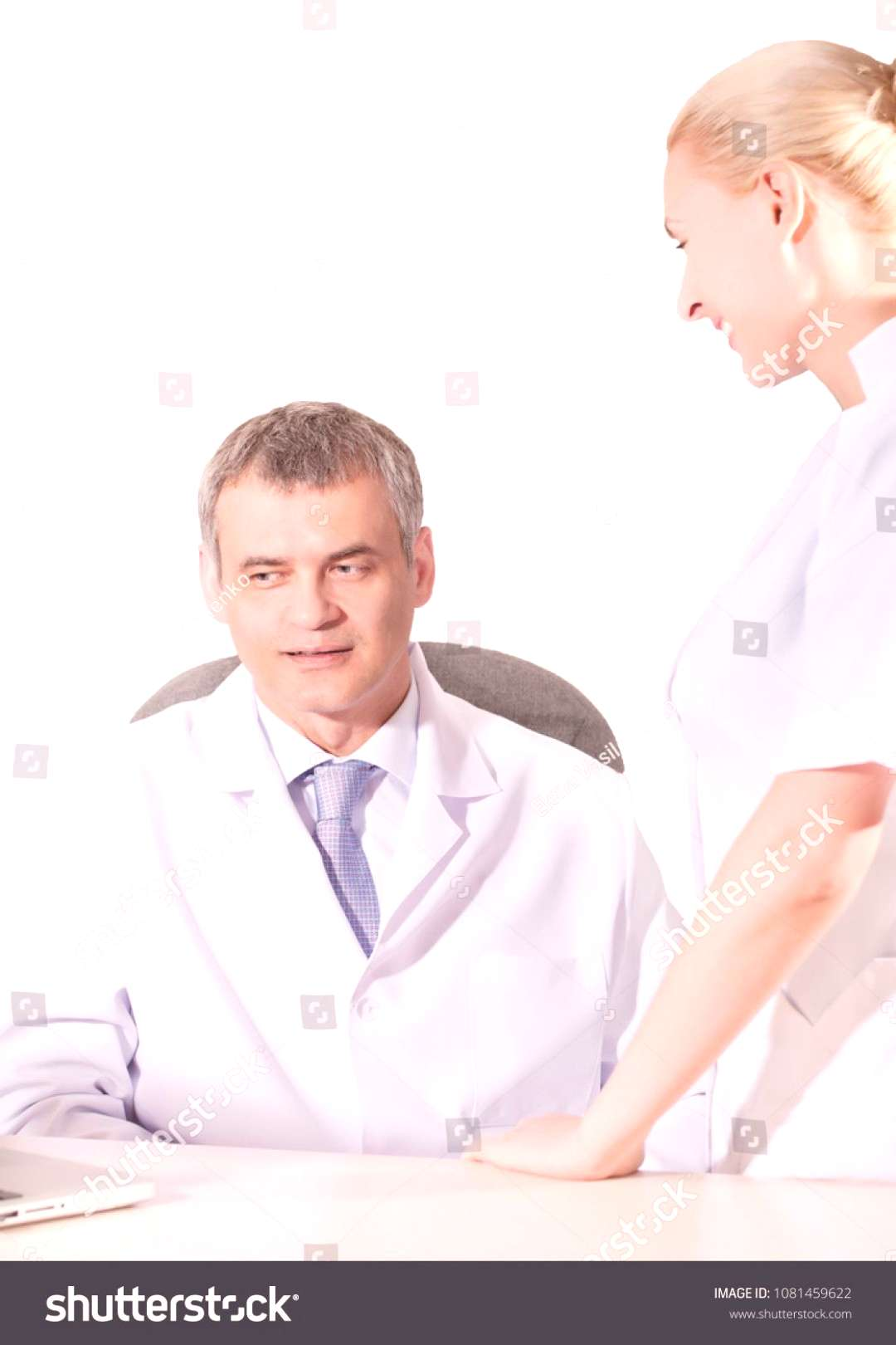 two doctors have conversation in medical office ,