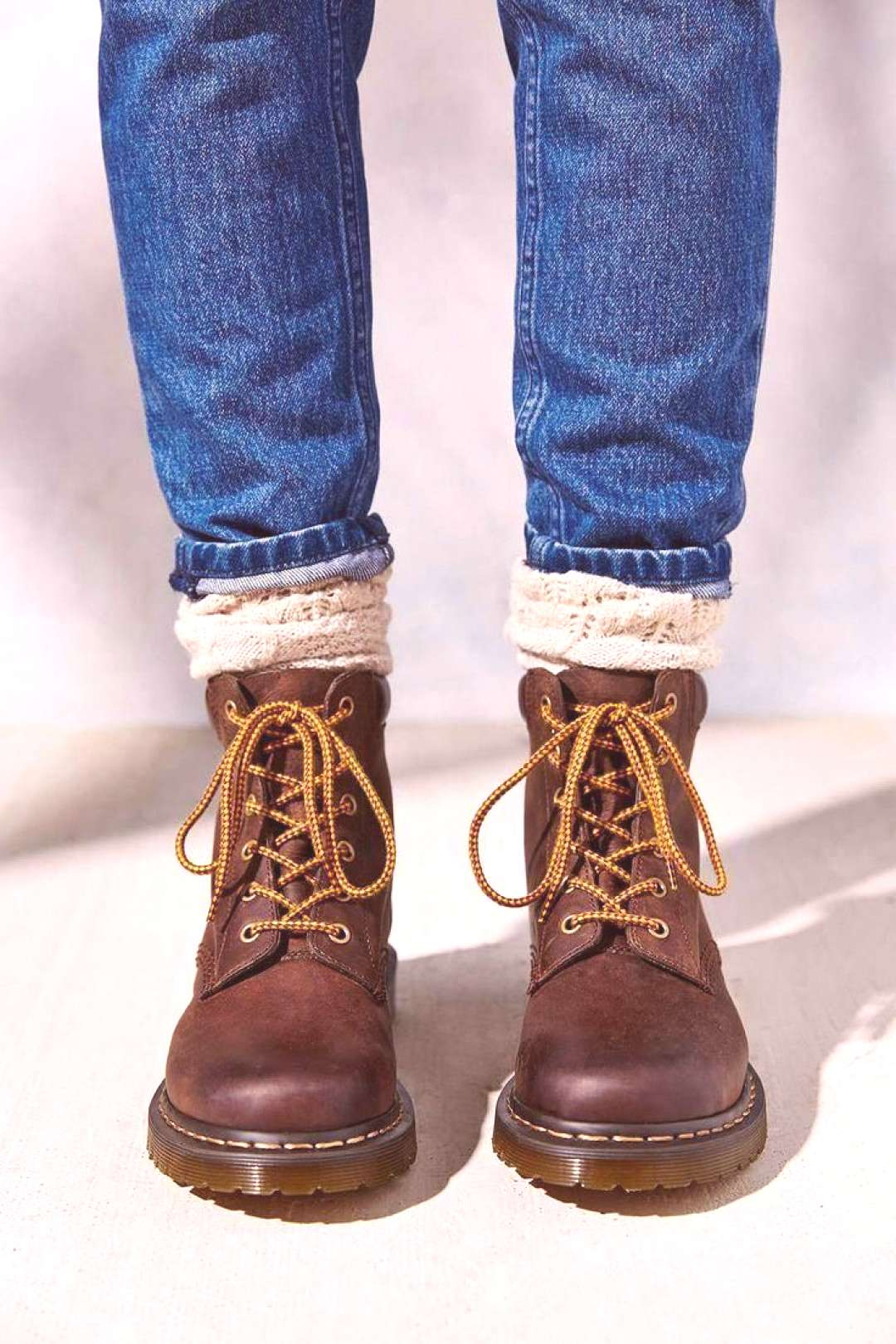 Wear them like you would riding boots chunky boot socks and skinny jeans, rolled up to show off so